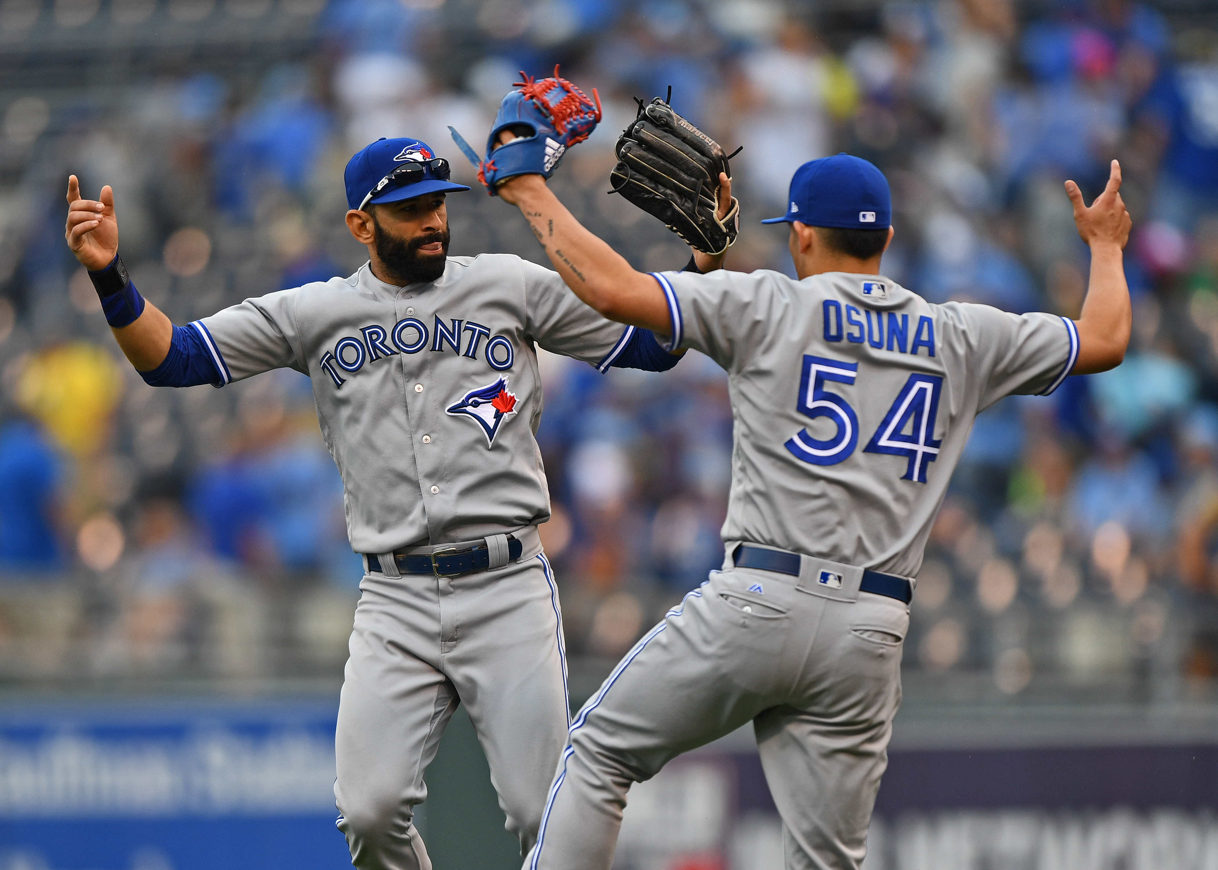 Jun   Kansas City Mo Usa Toronto Blue Jays Right Fielder Jose Bautista  Celebrates With Teammate Roberto Osuna  After Beating The Kansas